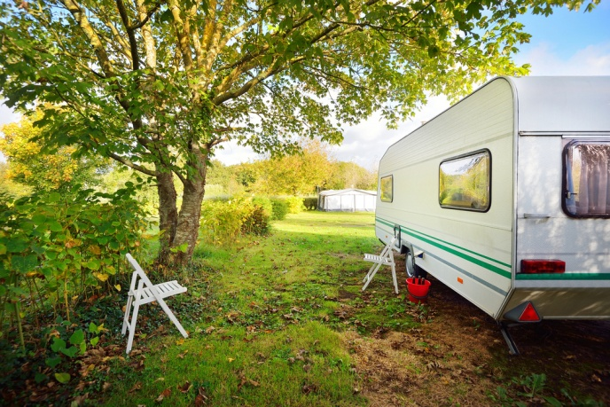 caravan in field in autumn
